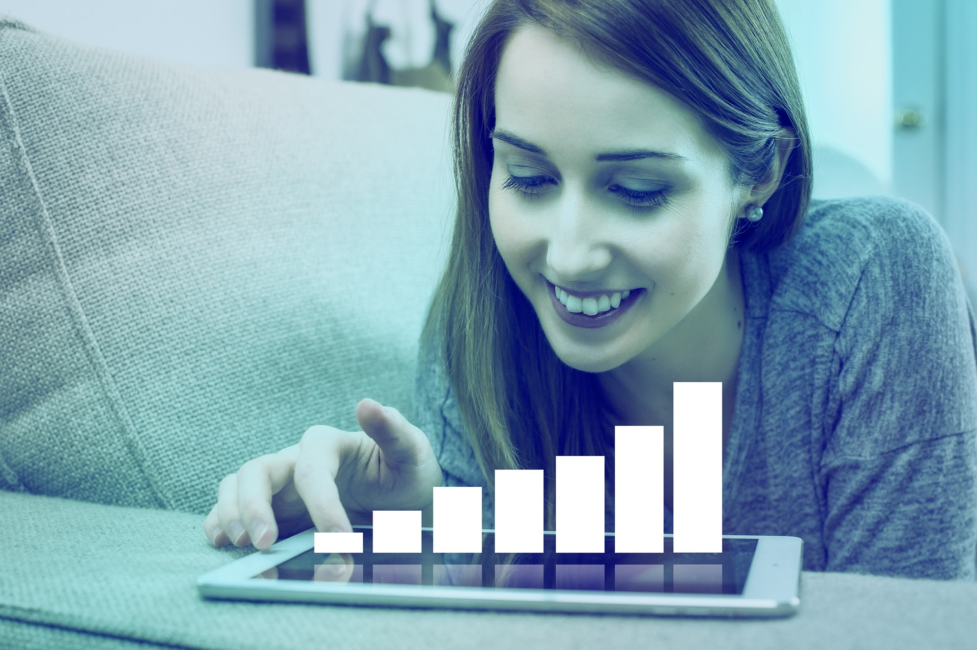 Woman looking at charts on tablet