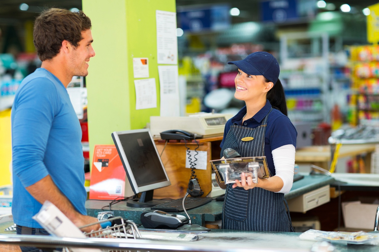 Counter Saleswoman making a sale